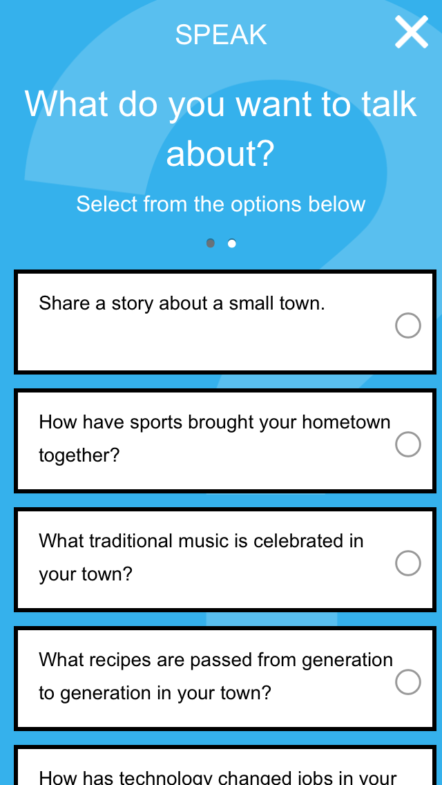A view of the speak screen in the Be Here: Stories app is on a blue background and ask users what they want to say.